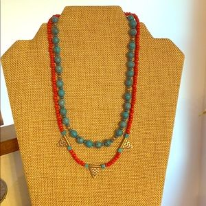 Necklaces with faux turquoise and coral beads.